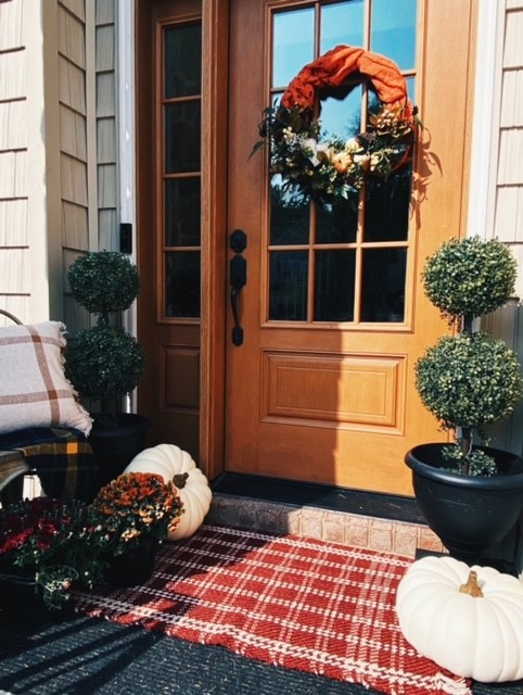 Decorate your front porch for Fall with pumpkins, mums, and wreaths