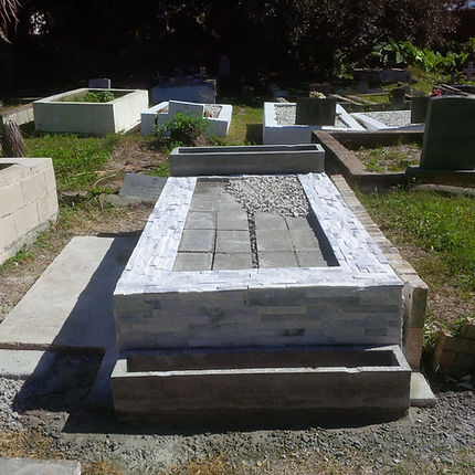 New Orleans cemetery restoration tomb repair grave cleaning painting headstone engraving