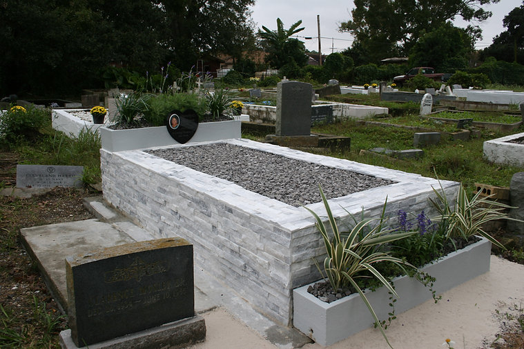 New Orleans cemetery restoration tomb repair grave cleaning painting headstone repair