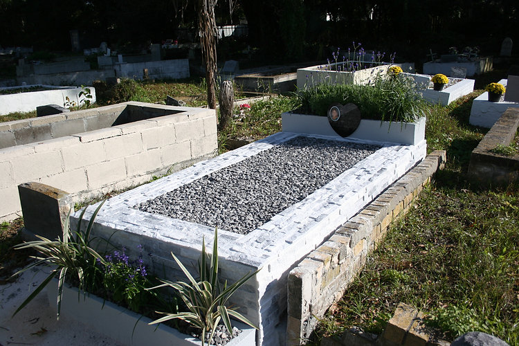 New Orleans cemetery restoration tomb repair grave cleaning painting