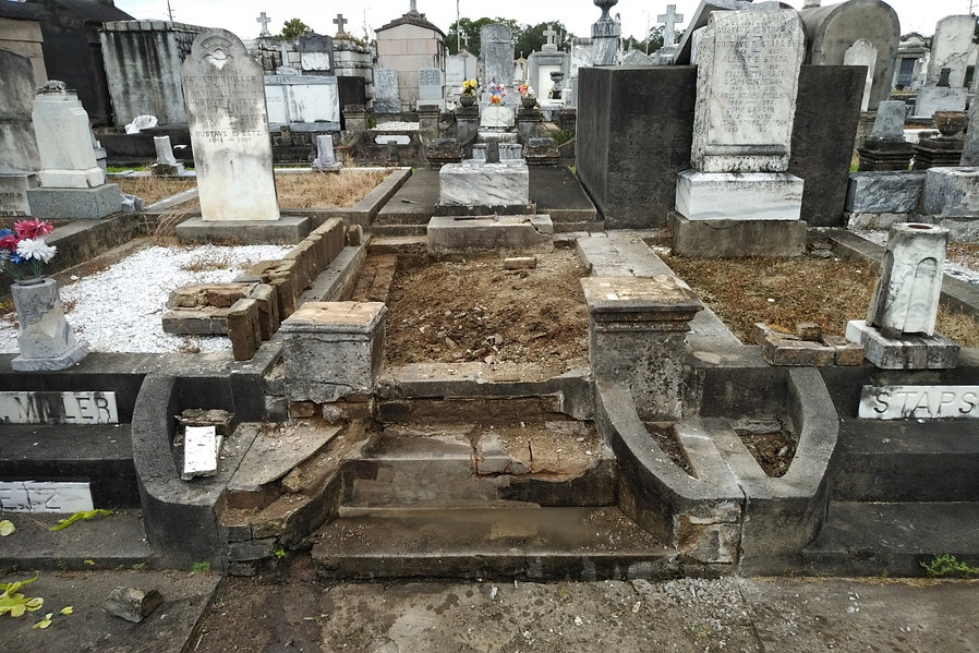 New Orleans cemetery restoration, tomb repair, cemetery repair, tomb restoration, tomb repair, New Orleans cemetery grave tomb cleaning painting