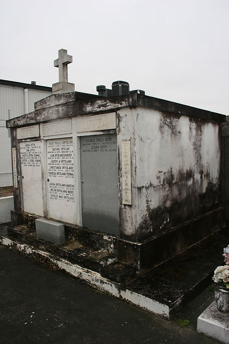 New Orleans tomb restoration, cemetery repair, tomb repair cleaning painting