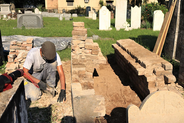 New Orleans cemetery restoration, tomb repair, tomb restoration, cemetery repair, New Orleans tomb grave cleaning painting, new tombs