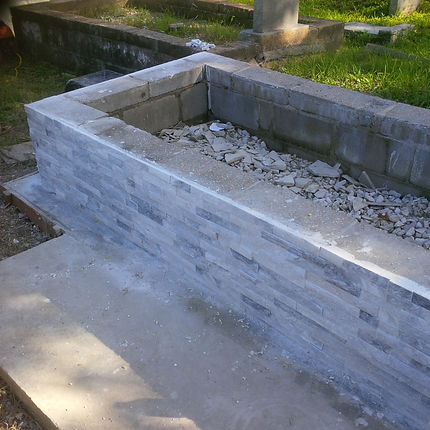 New Orleans tomb repair cemetery restoration grave cleaning painting