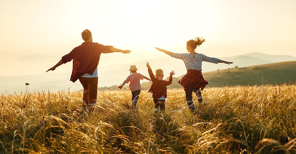 6801-family-running-field-sunlight-getty