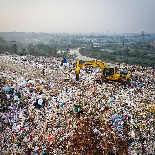 yellow-excavator-on-piles-of-trash-31743