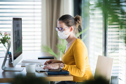 Woman working indoors at home office.jpe