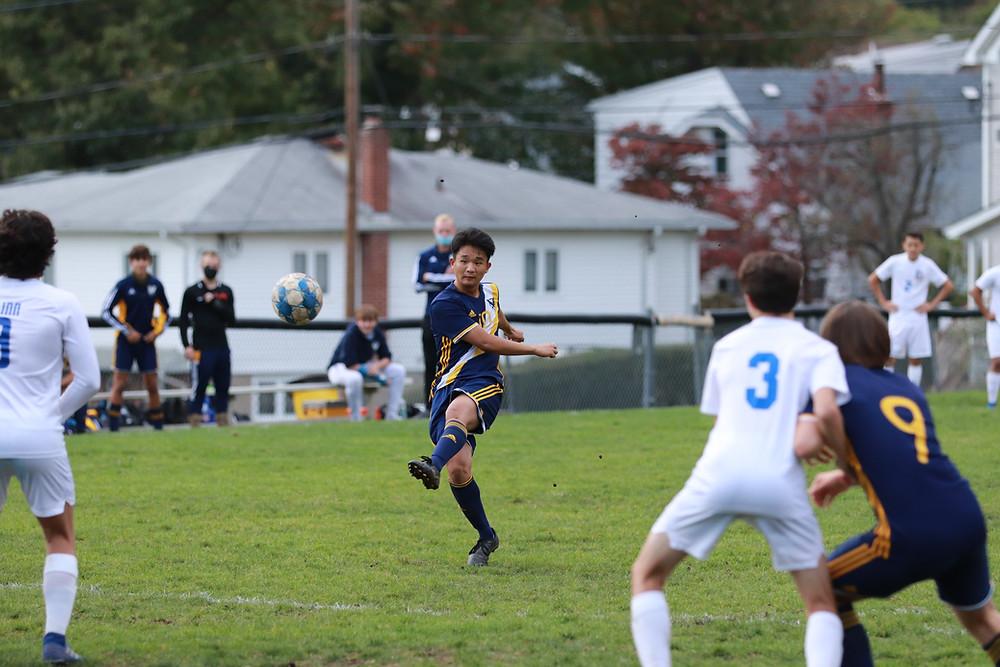 Senior Logan Kang makes a goal attempt.