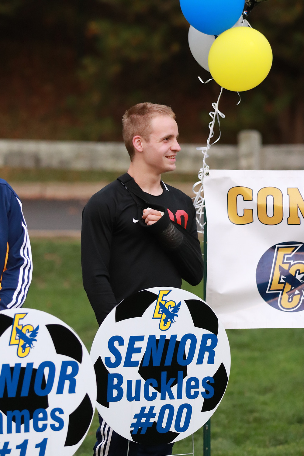 Senior Daniel Buckles (did not play due to injury) listens to the senior speeches.
