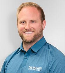 brett headshot blue shirt_edited.jpg