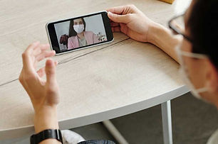man-having-a-video-call-on-his-phone-403
