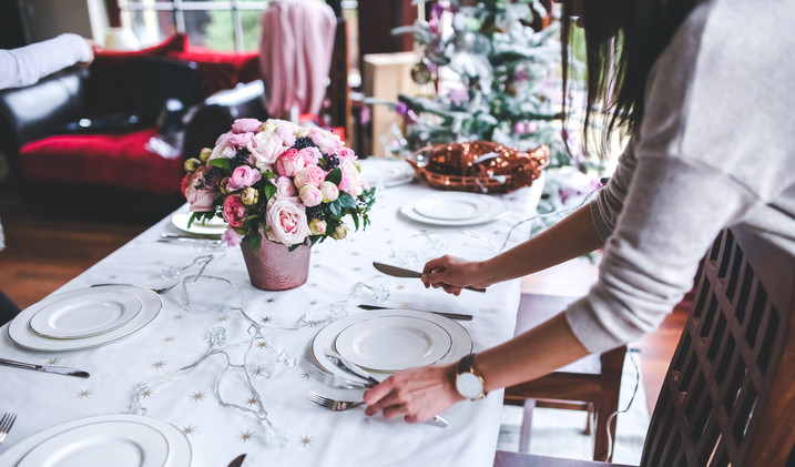Canva - Woman Preparing Christmas Table.