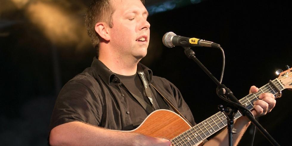 Andrew Gordon sings for a Hub fundraiser