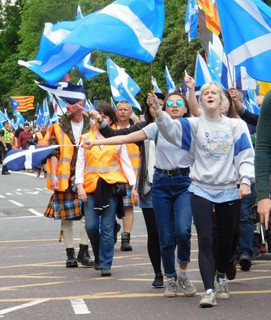 Yes supporters marching with flags