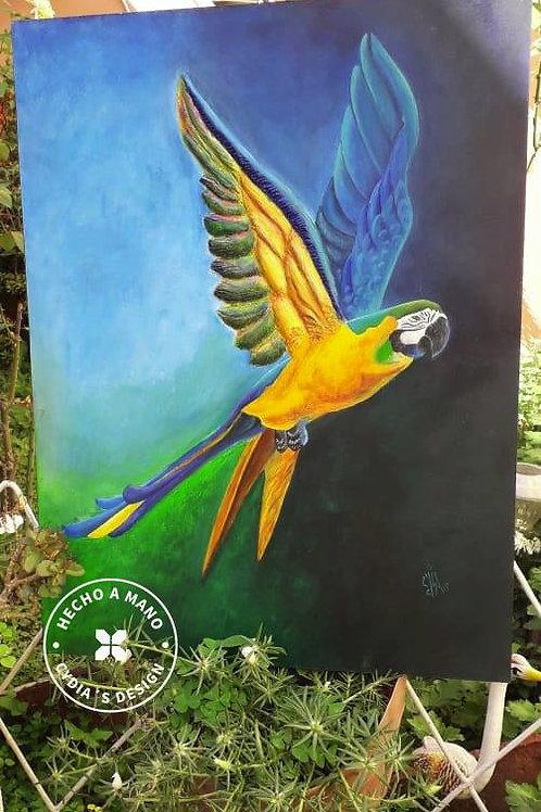 Guara azul extendiendo sus alas