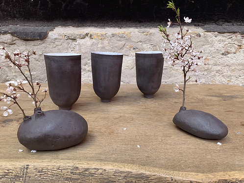 Stoneware tall cup on foot