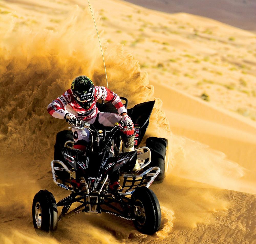 Person riding an atv in the desert