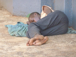 Street kid sleeping