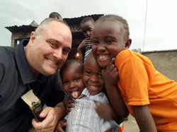 Jason with kids in the slums