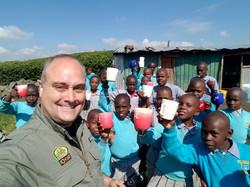 Kids getting clean water at school