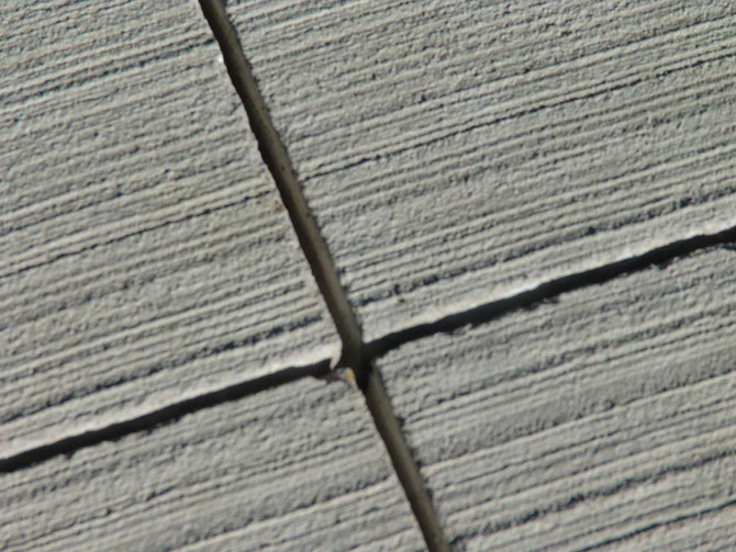 Caulking cracks in concrete slabs to help extend the life of your concrete slab.