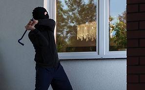 burglar-smashes-window.jpg