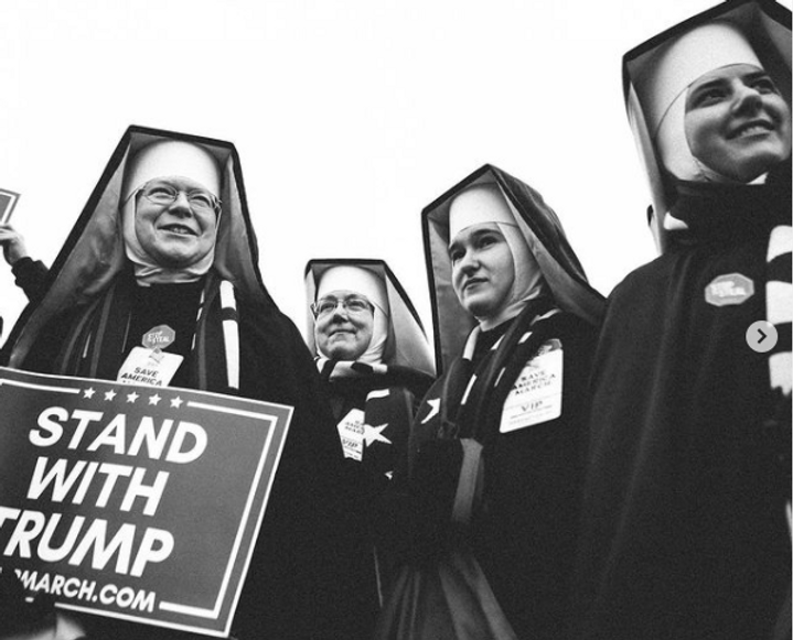 Nuns hold sign in support of Trump at the Capitol