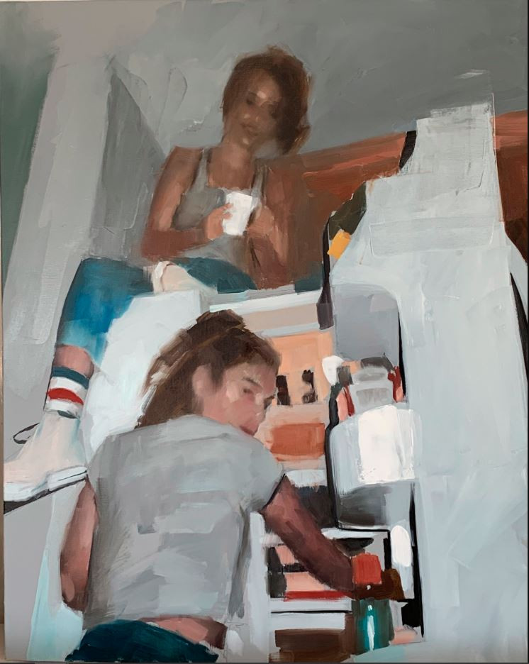 A young girl sits on a fridge while another stand in the open door