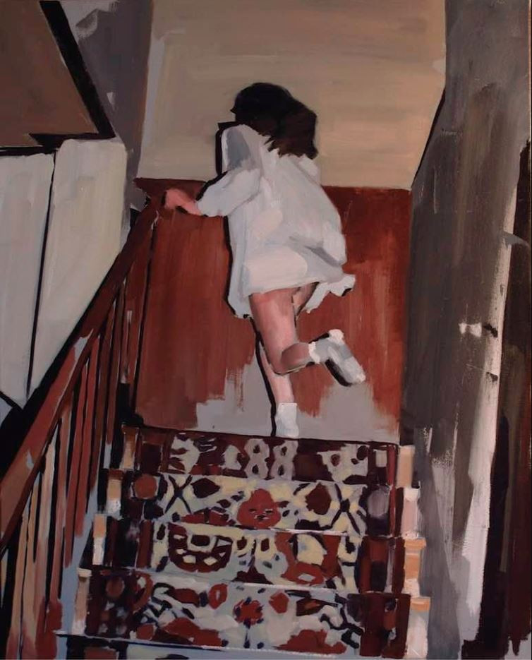 A young girl runs up the stairs in a white dress.