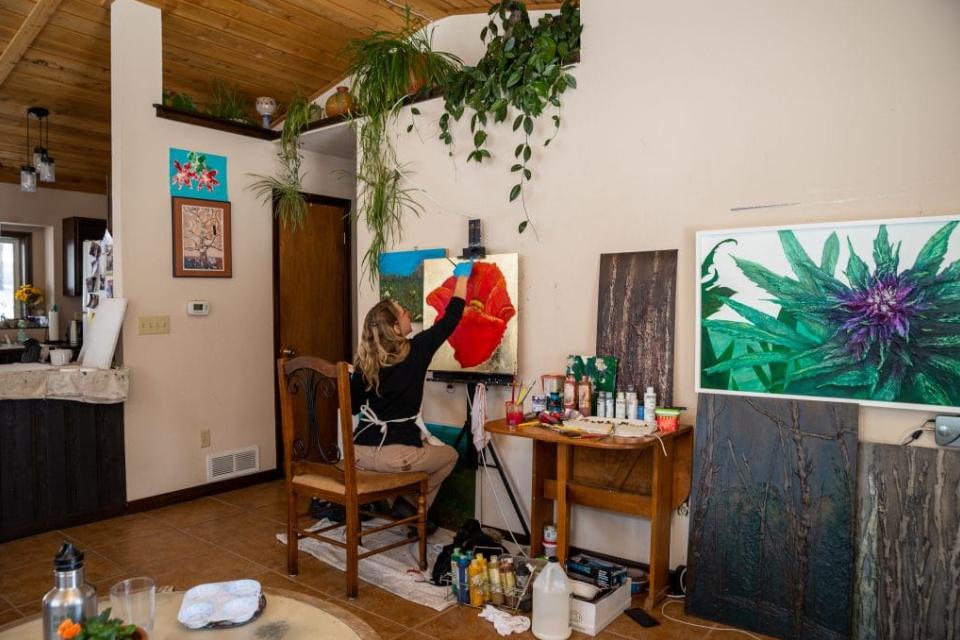 Alyssa Serpentini paintng in her studio