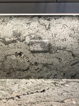 Matching switch plate and outlet to granite backsplash
