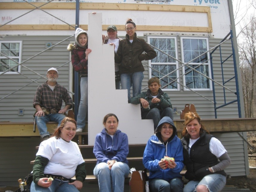 Jim (on left) working with Habitat for Humanity volunteers in Hartland