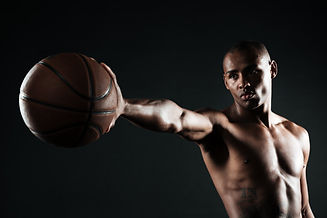 young-serious-basketball-player-holding-