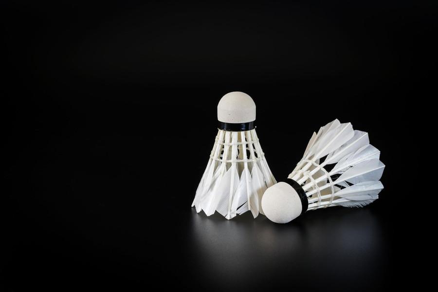 badminton-balls-on-black-background-free-photo.jpg