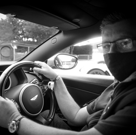 Vinnylondon at the helm of an Aston Martin