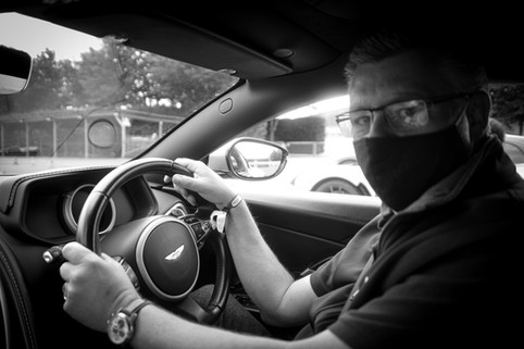 Vinnylondon atthehelm of an Aston Martin