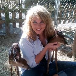 Ashton feeding the deer
