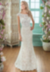 Bridal Gown F201015. Sophisticated fit and flare bridal gown with a bateau neckline and deep v back. This wedding dress has a pretty beaded waist band and tiffany train.