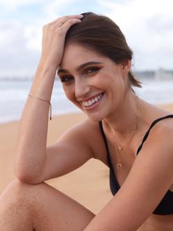 Model smiling on beach