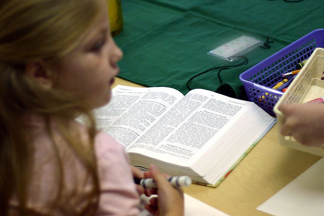 Child Reading Bible at St. Lucas UCC