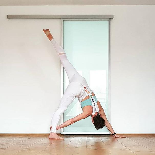 Yoga pose downward facing dog variation
