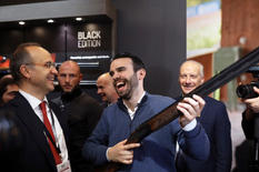 Trying new rifles at HIT Trade Show in Vicenza, Italy. 2019