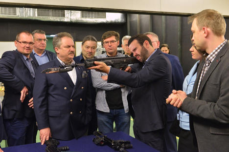 Trying new toys at an arm fair in Poland