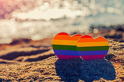 Two hearts of the color of the gay flag