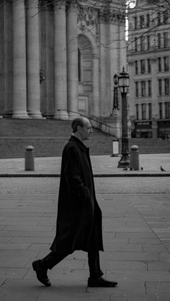 Man Walking in front of St Pauls
