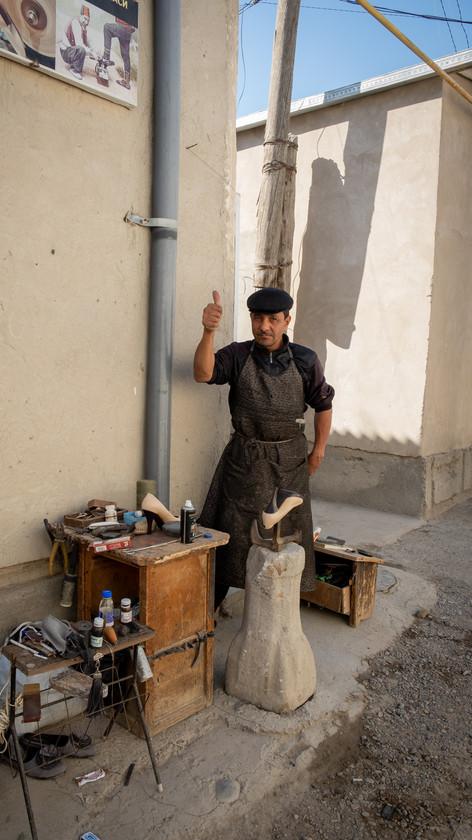 Shoe shiner in Bukhara, Uzbekistan, People of Bukhara