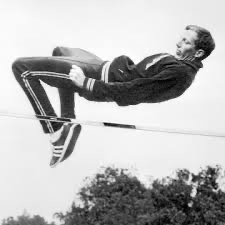 """Dick Fosbury's """"flops"""" over the bar in the high jump"""