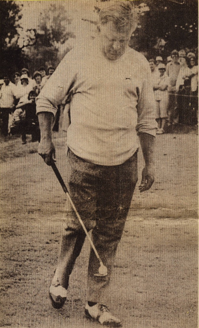 Moe Norman performs a balancing act with a golf club and ball at a tournament in Quebec
