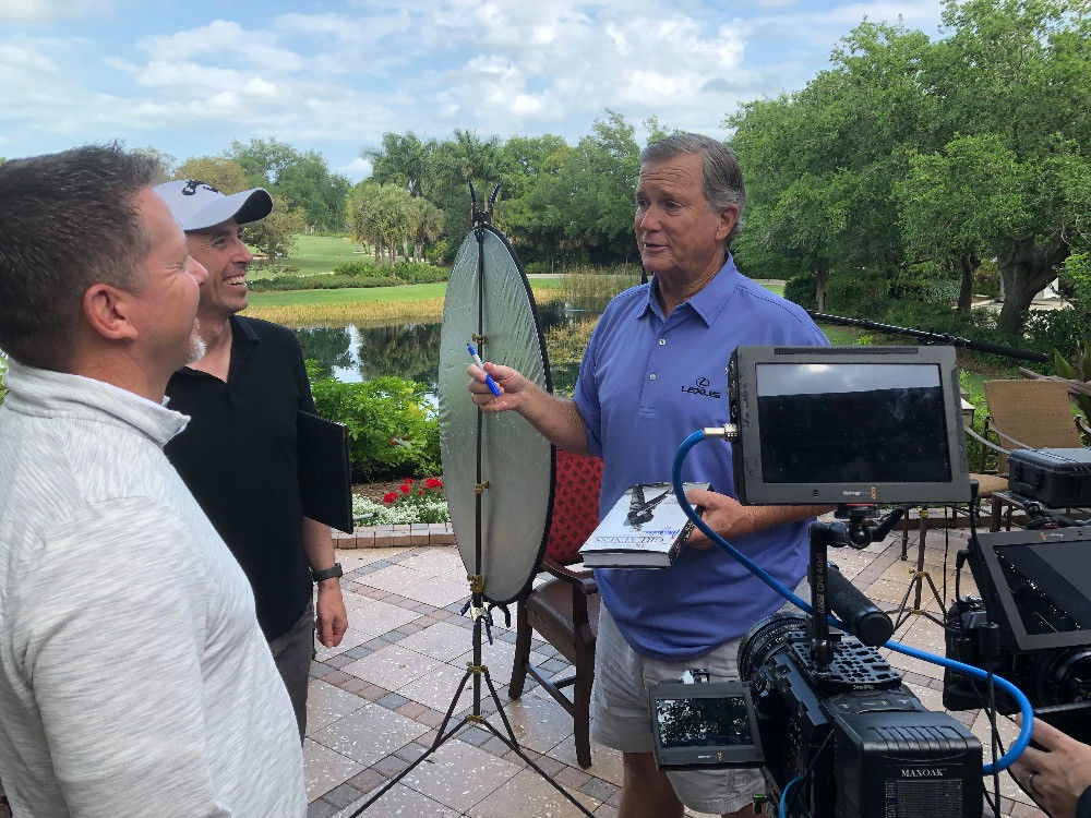 (Left to Right) Executive Producer Todd Graves, Director Nathan Edwards & PGA Tour Player  Peter Jacobsen talk following an on-camera interview