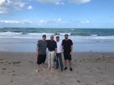 Film crew (left to right) Keenan Garrett, Barry Morrow, Nathan Edwards, and Spenser Sakurai between interviews in Vero Beach, FL